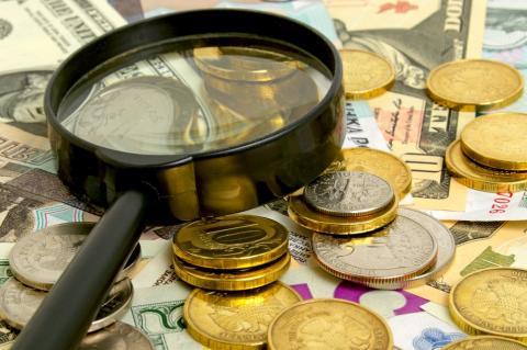 Деньги и лупа